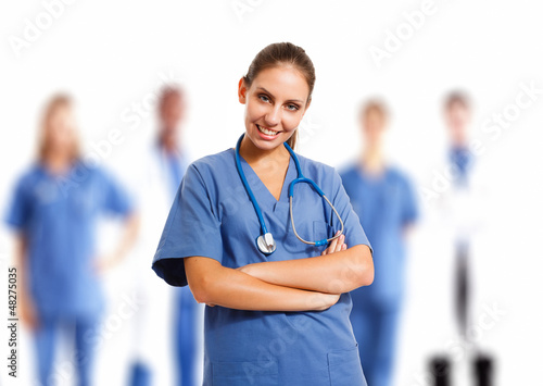 Beautiful nurse in front of her medical team