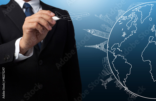 businessman drawing the concept travel around the world
