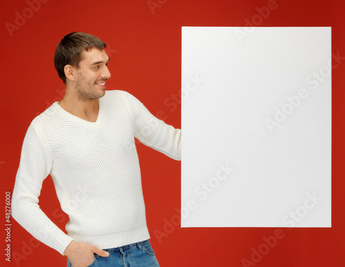 handsome man with big blank board