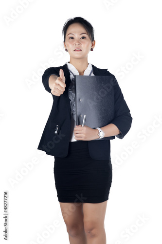 Successful business woman showing thumbs up sign, holding black