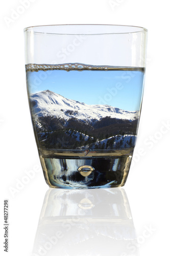 Glass of winter. Wintry landscape in a glass of water