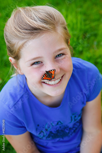 beautiful girl with a butterfly on her nose