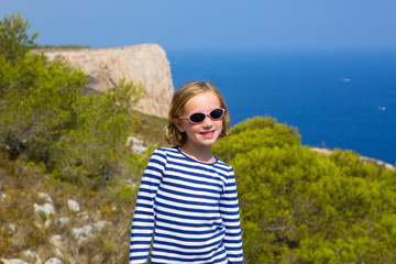 child kid girl in mediterranean sea with sailor stripes