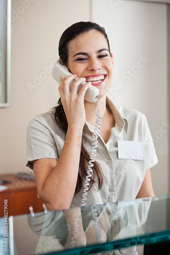 Happy Female Receptionist On Call