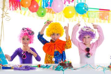 Children happy birthday party with clown wigs