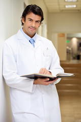 Mid Adult Doctor Holding Book