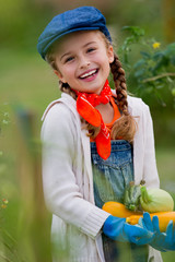 Vegetable garden - lovely girl with zuccini