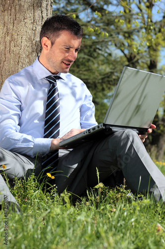 working with laptop in a park