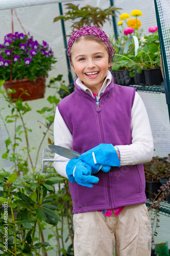 Gardening - lovely girl working in green house