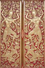 Ornate golden temple doors