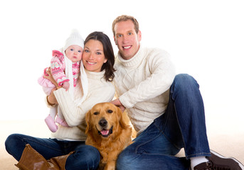 Baby girl mother and father family happy in winter and dog