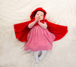 Baby Little Red Riding Hood on white fur