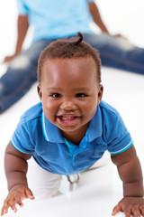 cute african american baby boy crawling on floor