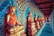 Leinwandbild Motiv golden statues of Buddha in Wat Arun temple, Bangkok