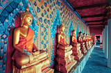 Fototapety golden statues of Buddha in Wat Arun temple, Bangkok