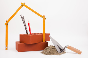 sand pile, bricks and mason tools
