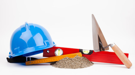 blue hardhat and mason tools