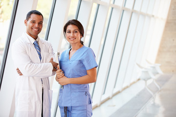 Portrait Of Medical Staff In Corridor Of Modern Hospital