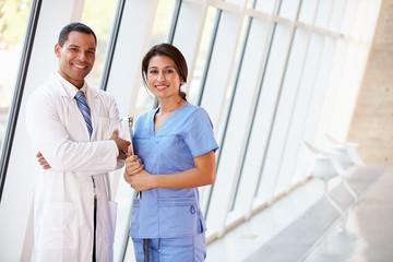 Portrait Of Medical Staff In Corridor Of Modern Hospital