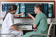 Medical Technicians Pointing At MRI X-ray