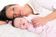 Baby girl sleeping with mother care near
