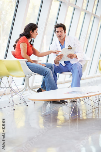 Doctor Offering Counselling To Depressed Woman