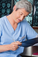 Medical Professional Going Through Document