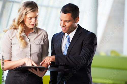 Businessman And Businesswomen Having Informal Meeting In Office