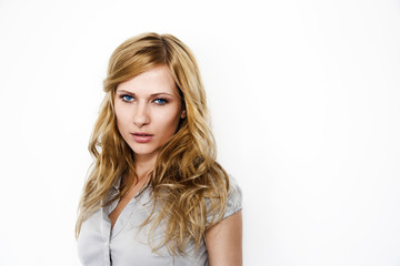 Closeup of blond woman on white background