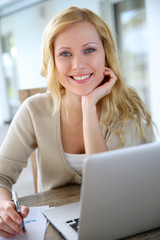 Smiling woman working from home on laptop