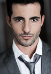 Portrait of handsome man on dark background