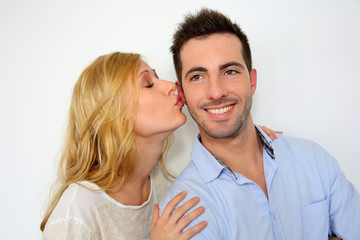 Girl kissing boyfriend on white background