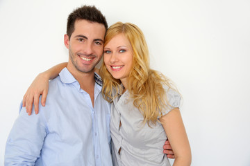 Sweet couple embracing on white background
