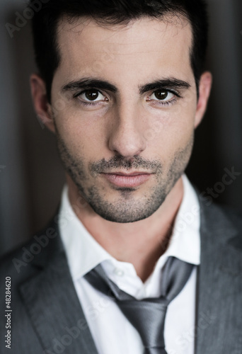 Portrait of handsome man on dark background