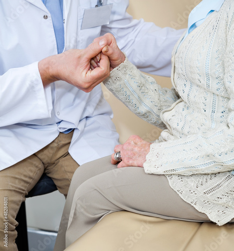 Doctor Comforting Female Patient