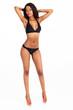 slim young african american woman in bikini on white background