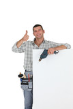Thumbs up from a builder with a blank board