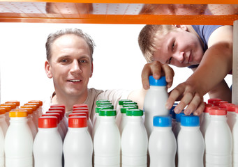 men selects dairy products in the shop