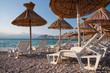 Deck chairs and sunshade on beach at Baska - Krk - Croatia