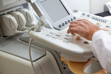 Radiologist Operating Ultrasonic Machine