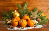 christmas composition with oranges and fir tree,