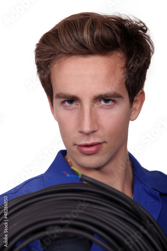 Man with cable reel