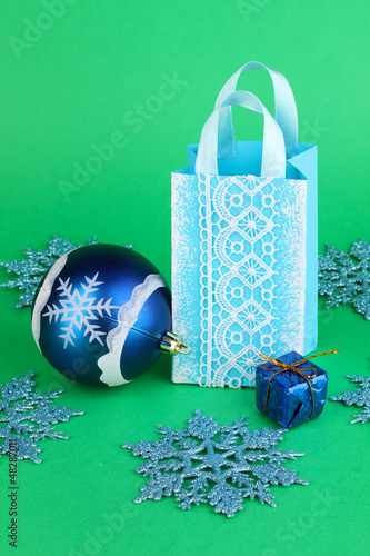 Christmas paper bag for gifts on green background