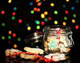 Christmas treats in bank on Christmas lights background