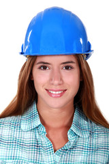 Portrait of young girl with blue helmet
