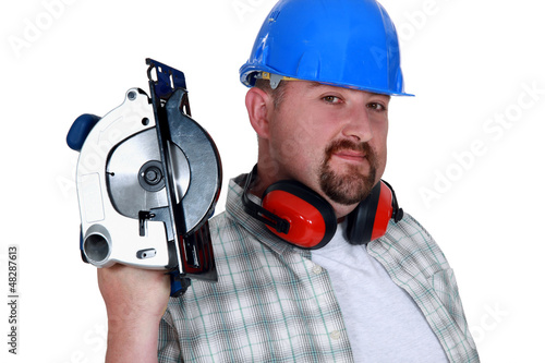 Bearded man holding circular-saw