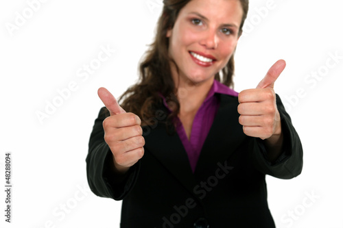 A businesswoman giving the thumbs up.