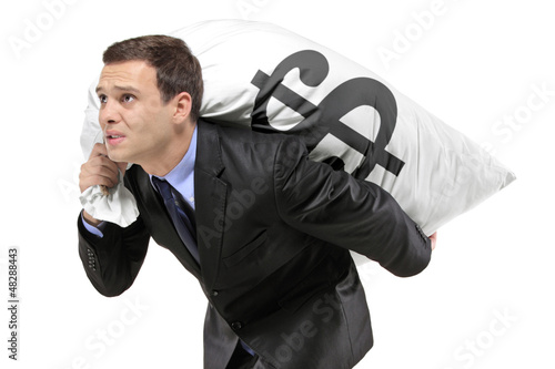 A businessman carrying a money bag with US dollar sign