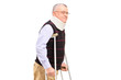 A gentleman with neck holder using crutches