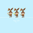 3 Bunnies Holding Spring Flowers